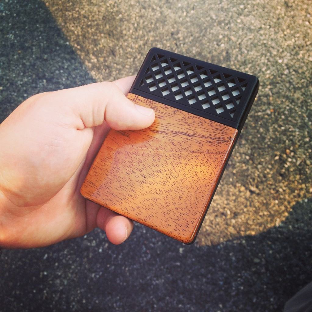 3D printing, NFC, mahogany woodwork, and paper all in one handheld object.